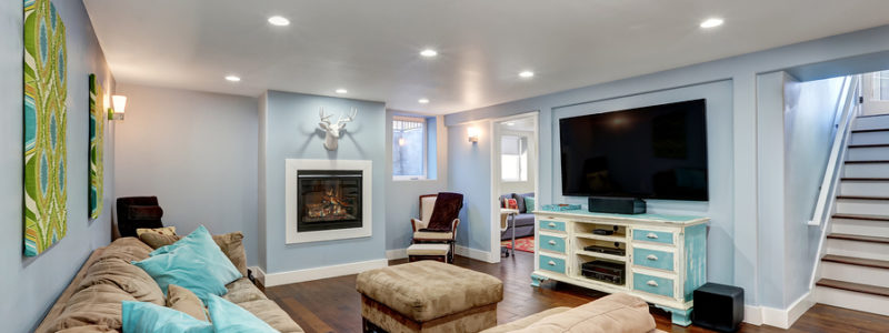 Pastel blue walls in basement living room interior with flooring from Best at Flooring.
