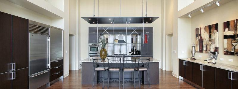 Sleek modern kitchen with large marble island